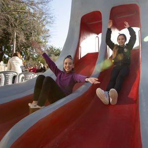 Sliding down the King Slide at the opening